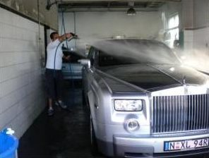 Picture of a Rolls Royce getting a car wash